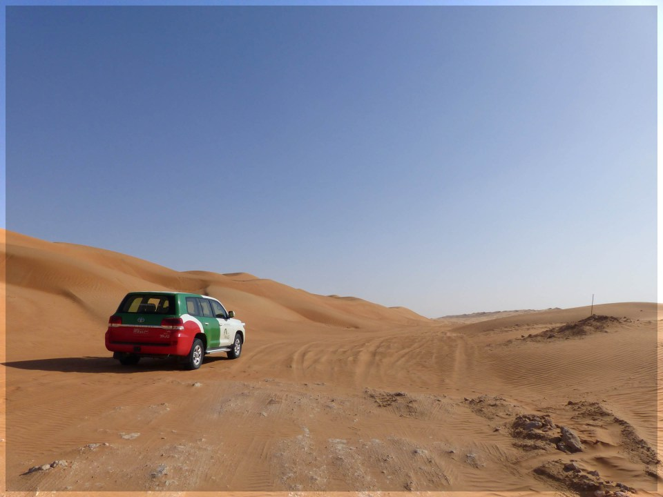 Jeep driving through sand dunes
