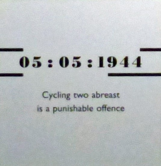 Poster with rule prohibiting cycling two abreast