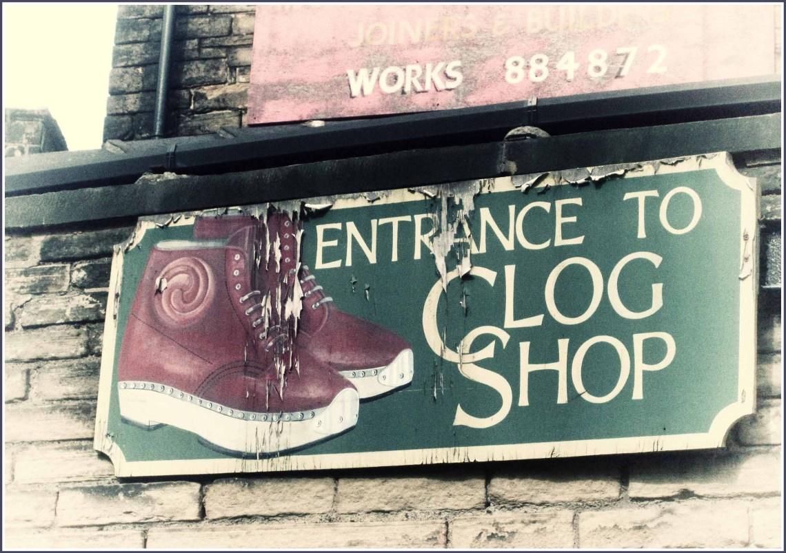 Old sign advertising a clog shop entrance