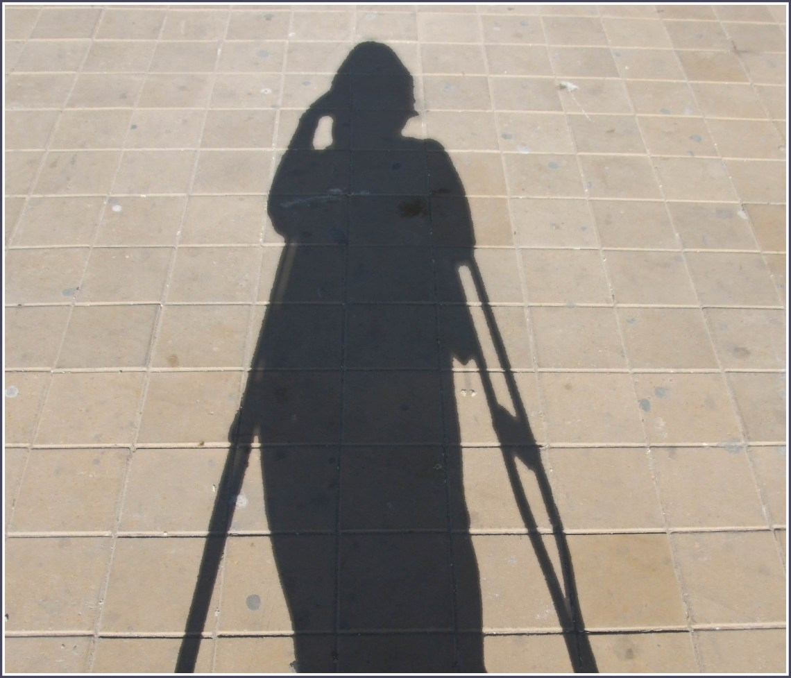 Shadow of lady with crutches