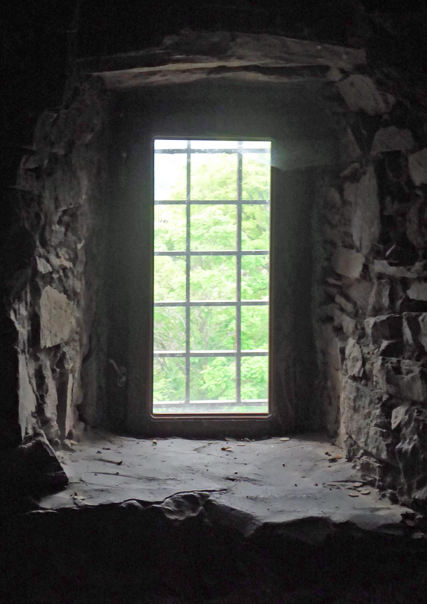 Small window set in a thick stone wall