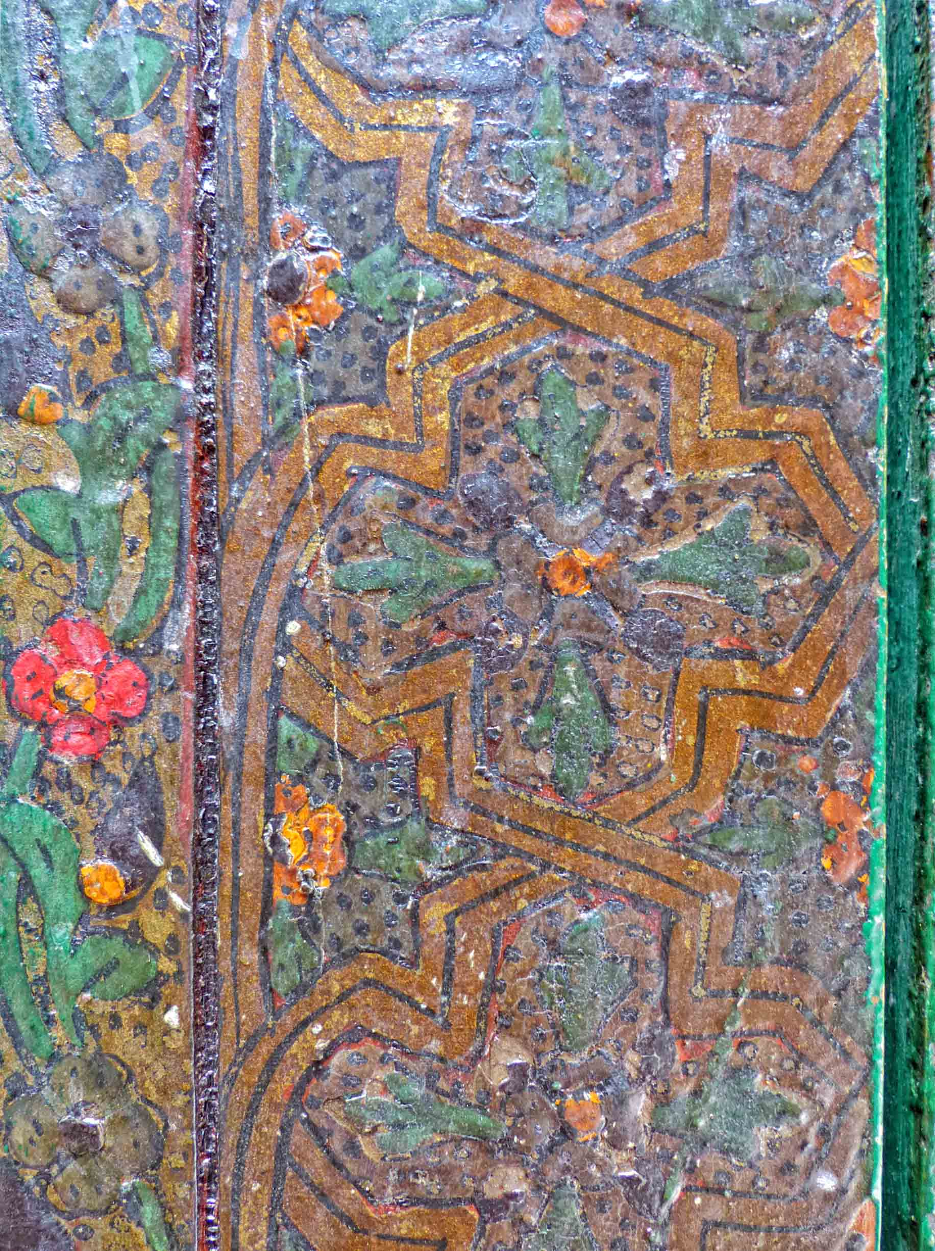 Painted wood with patterns and red and yellow flowers