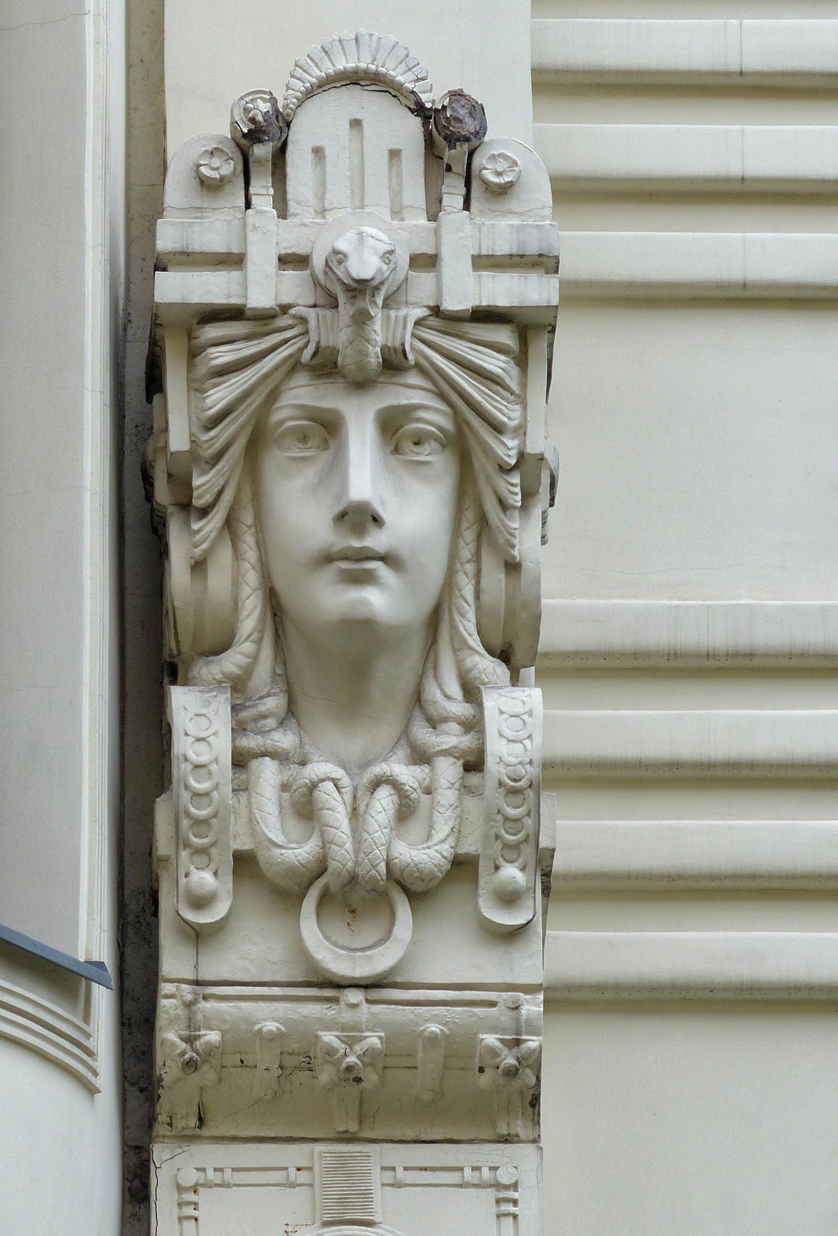 Stone face carved on a building