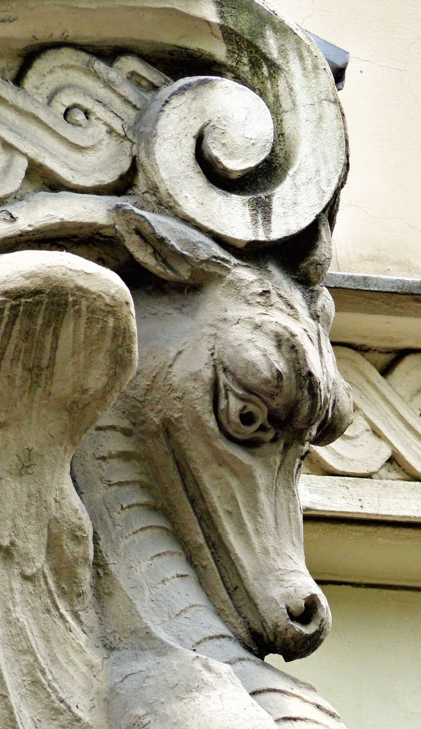 Stone dragon on the corner of a building