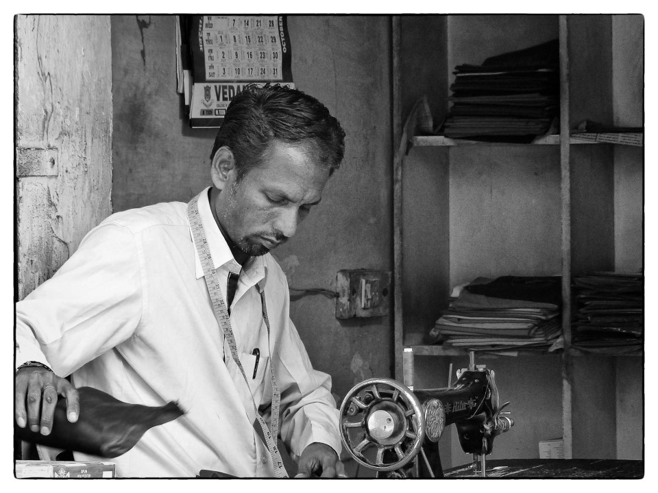 Black and white photo of tailor