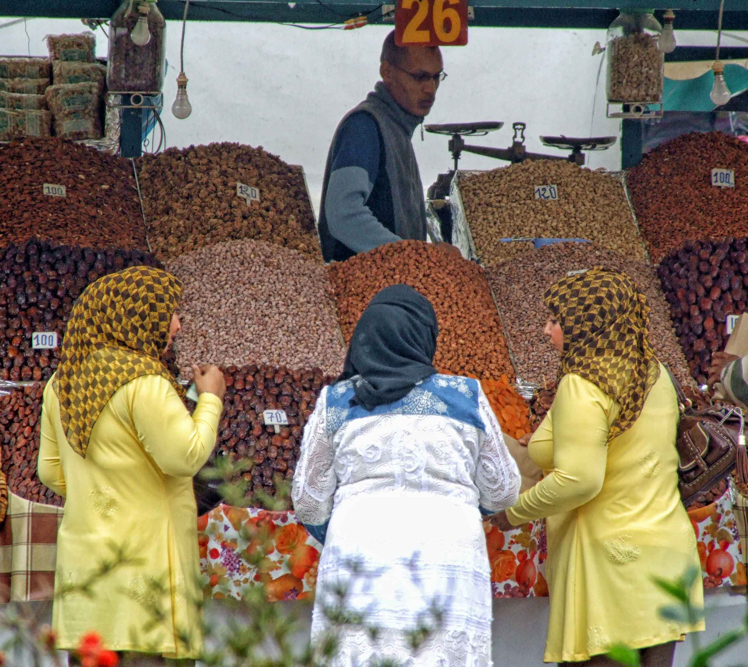 Three women at a dried fruit stall