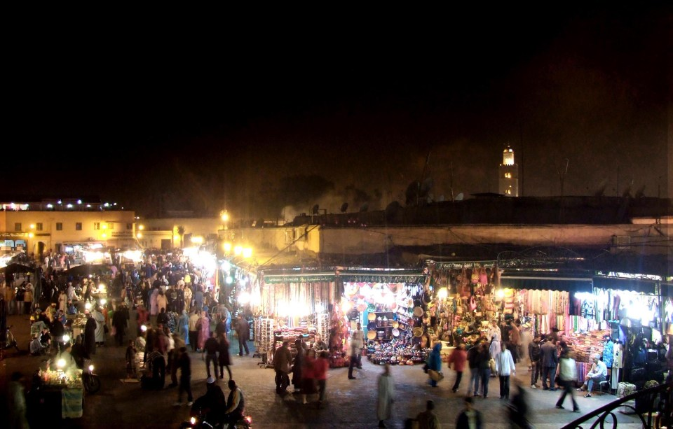 Brightly lit stalls in a night-time market square