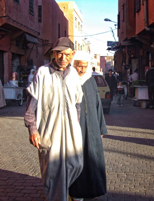 Two men in traditional Arab dress