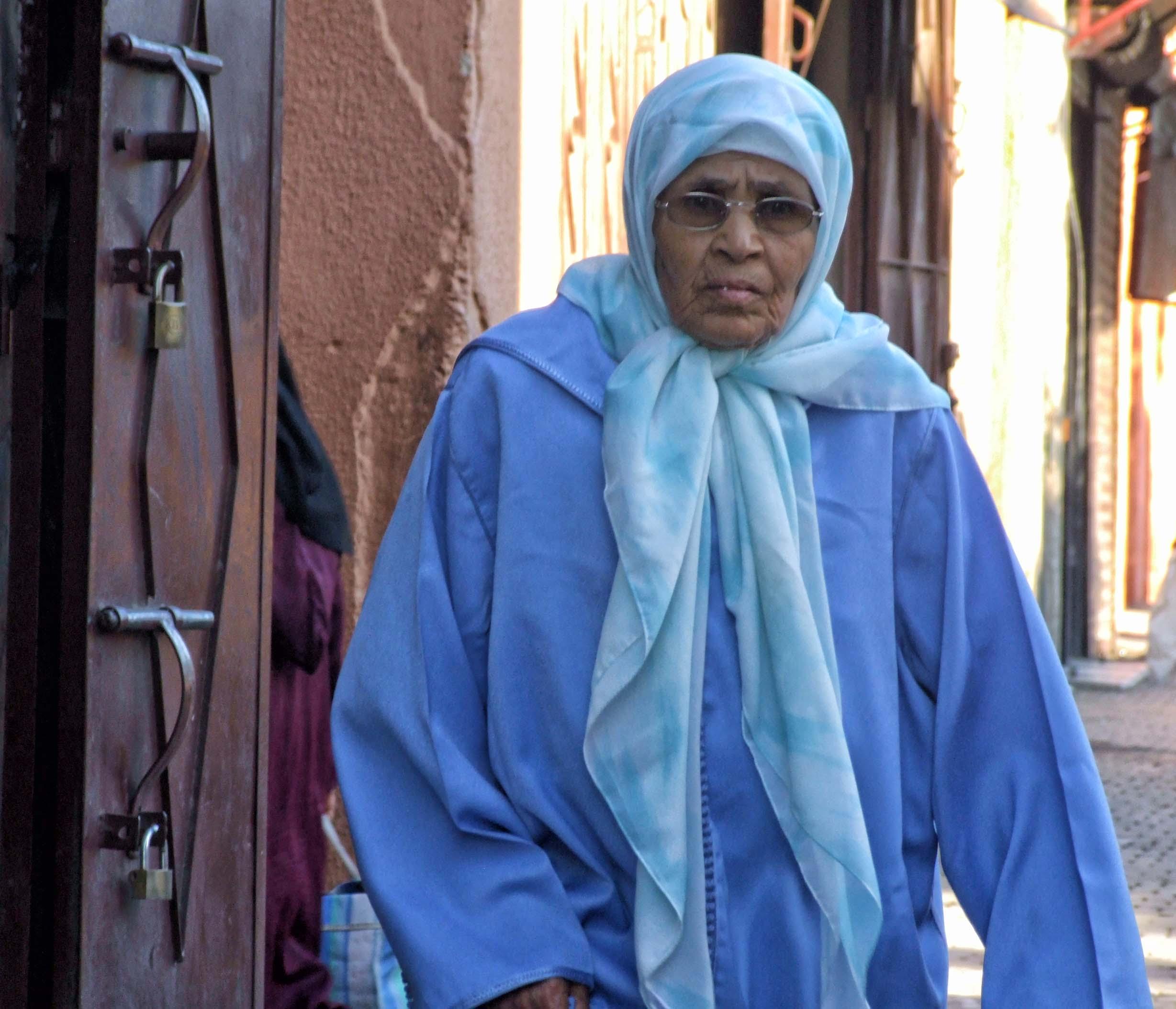 Elderly lady in blue robes