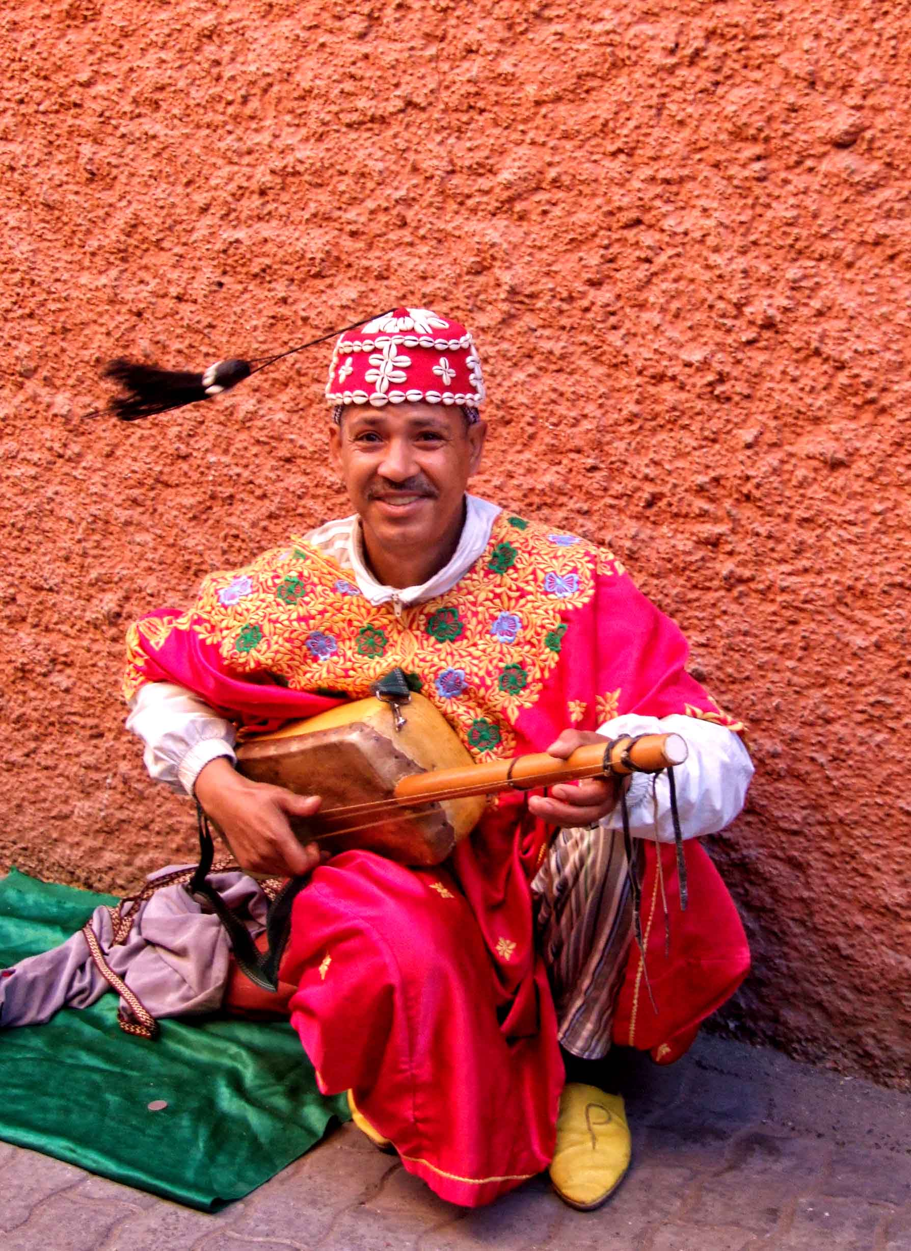 Musician in red robes