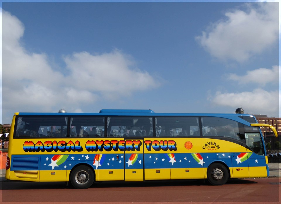 Large brightly painted tour bus