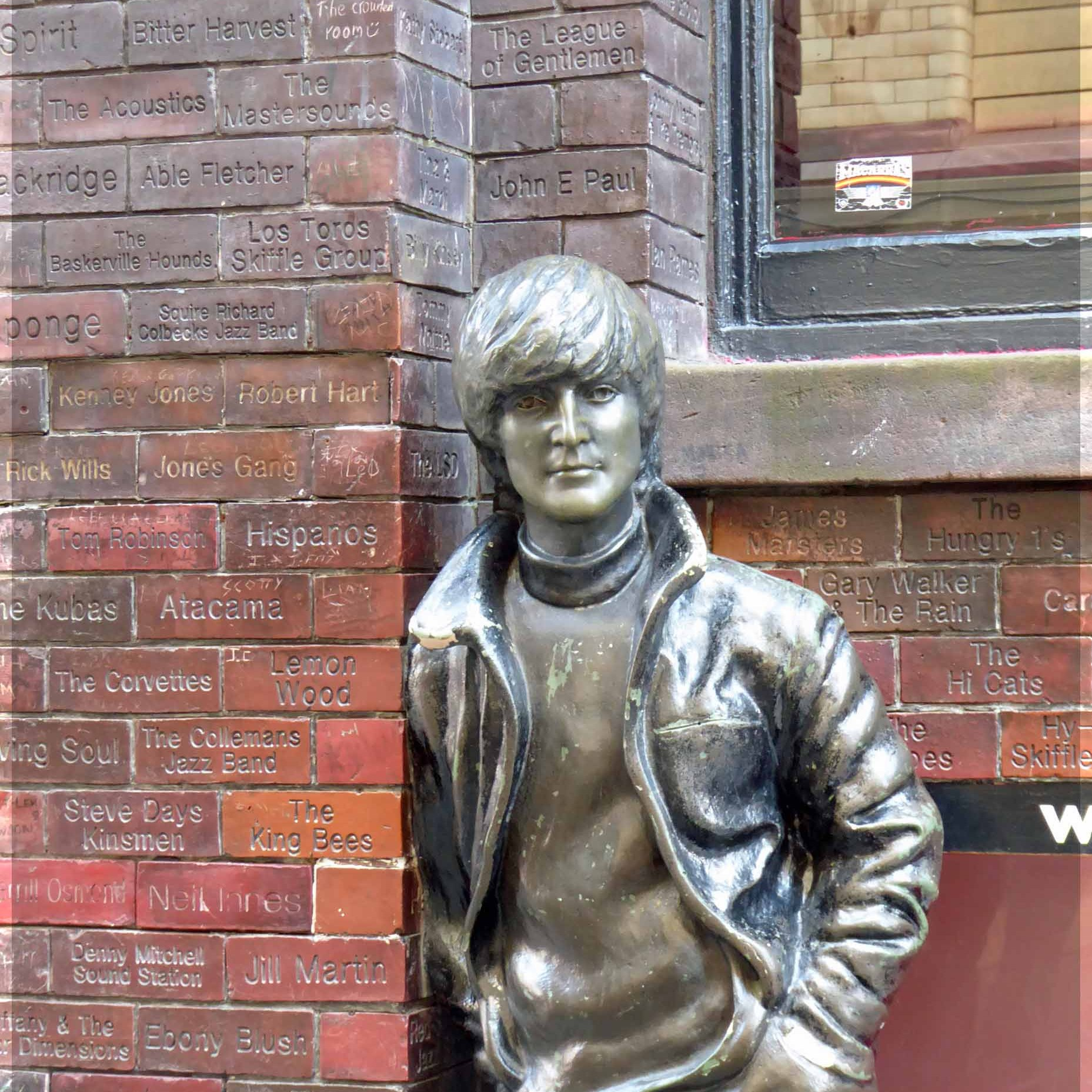 Statue of young man in leather jacket