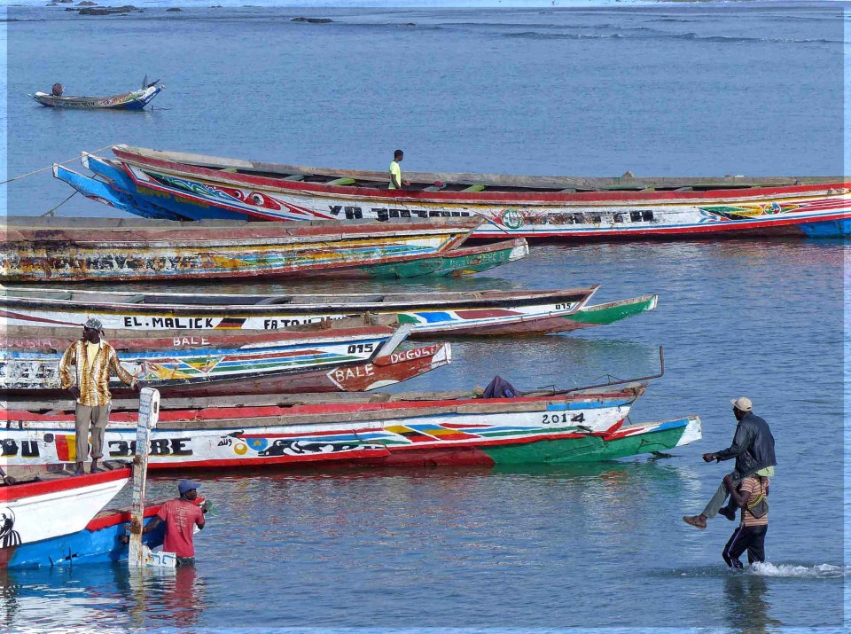 Colourful small boats on a river