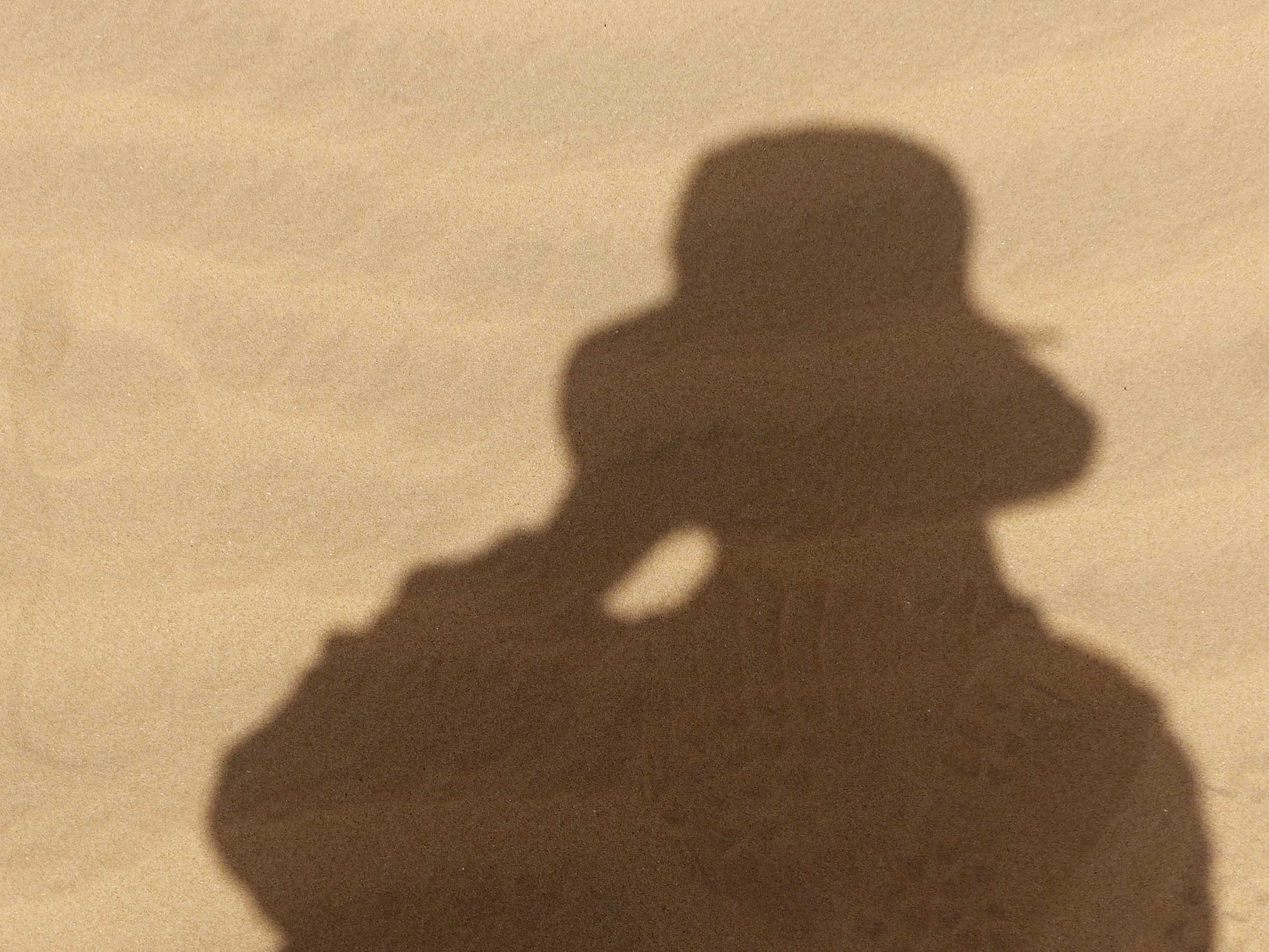 Shadow of a woman wearing a hat