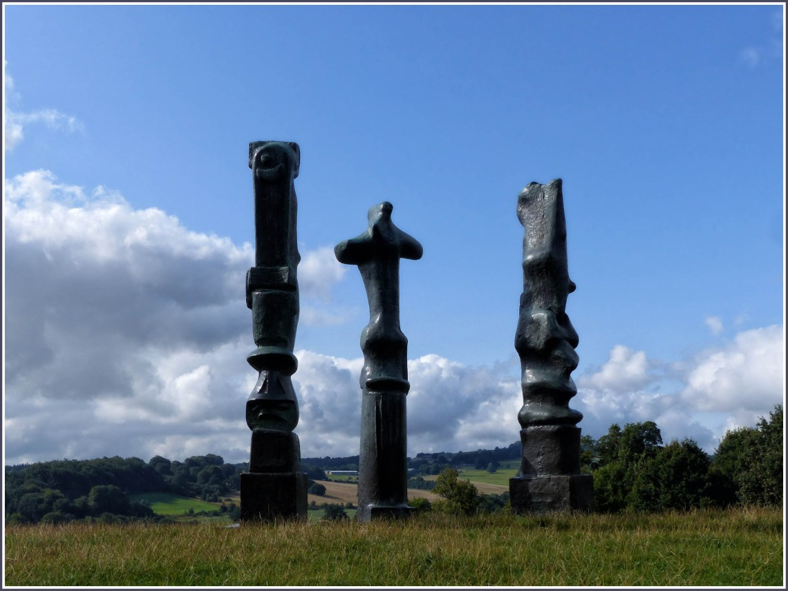 Three large sculptures in a landscape
