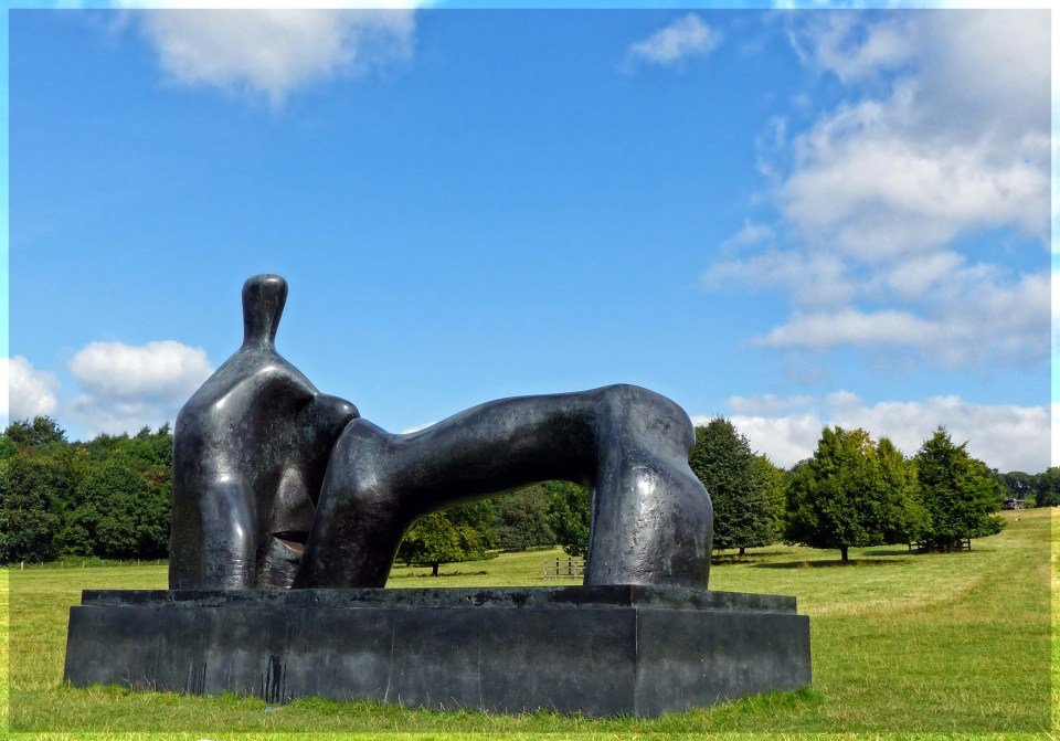 Large abstract sculpture set in a landscaped park