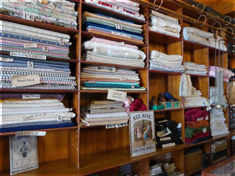 Wooden shelves with rolls of fabric
