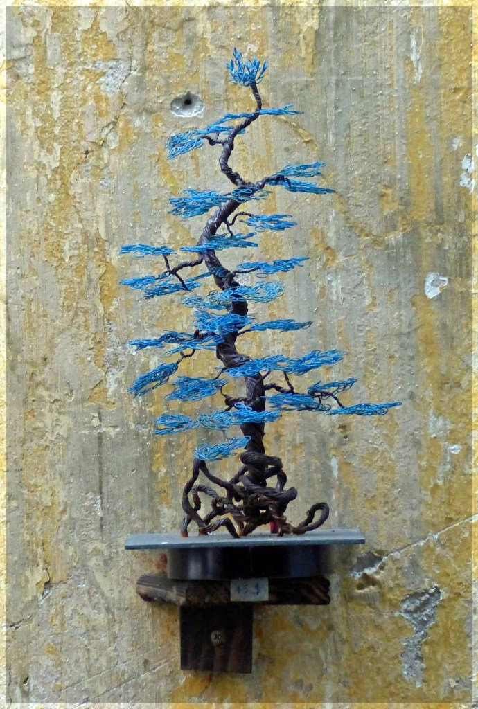 Model of bonsai tree with blue leaves