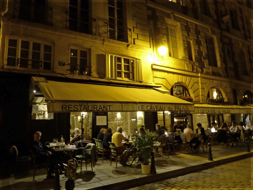 Restaurant at night with pavement tables