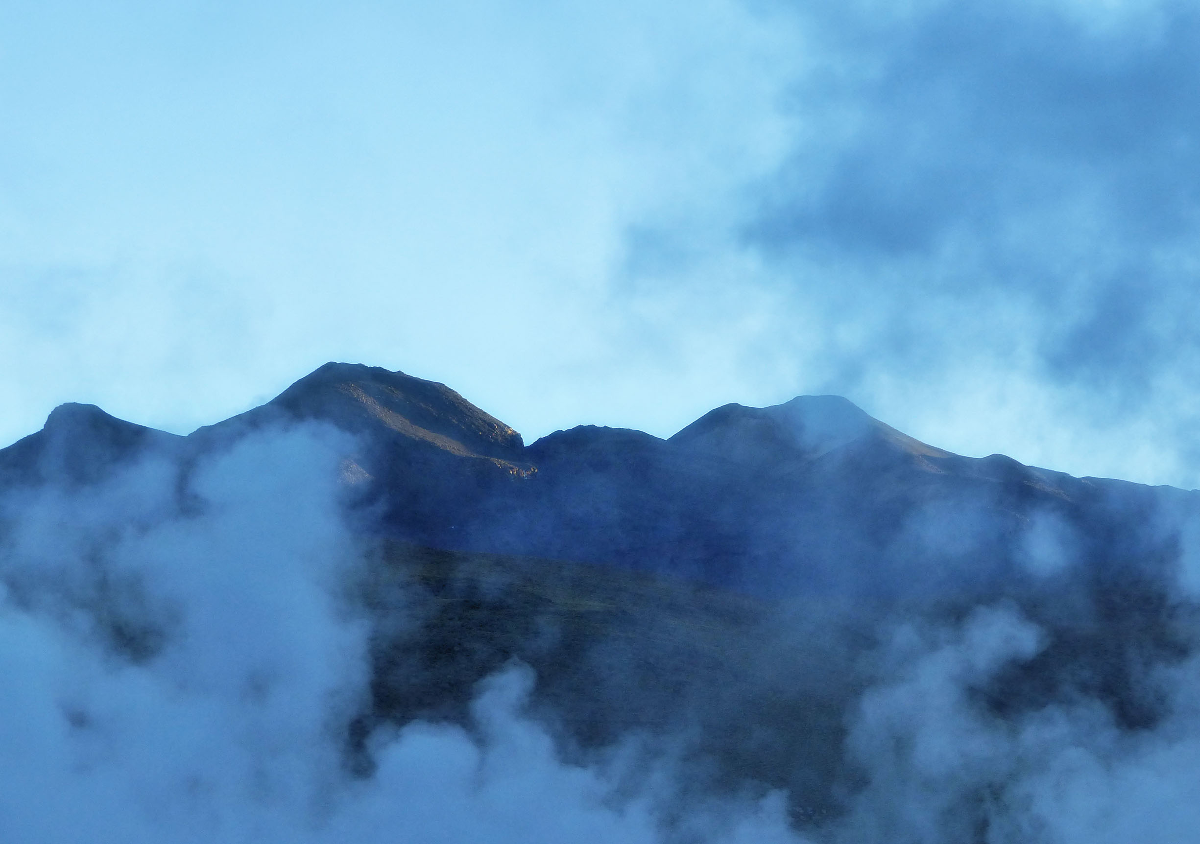 Steam rising in front of mountain backdrop