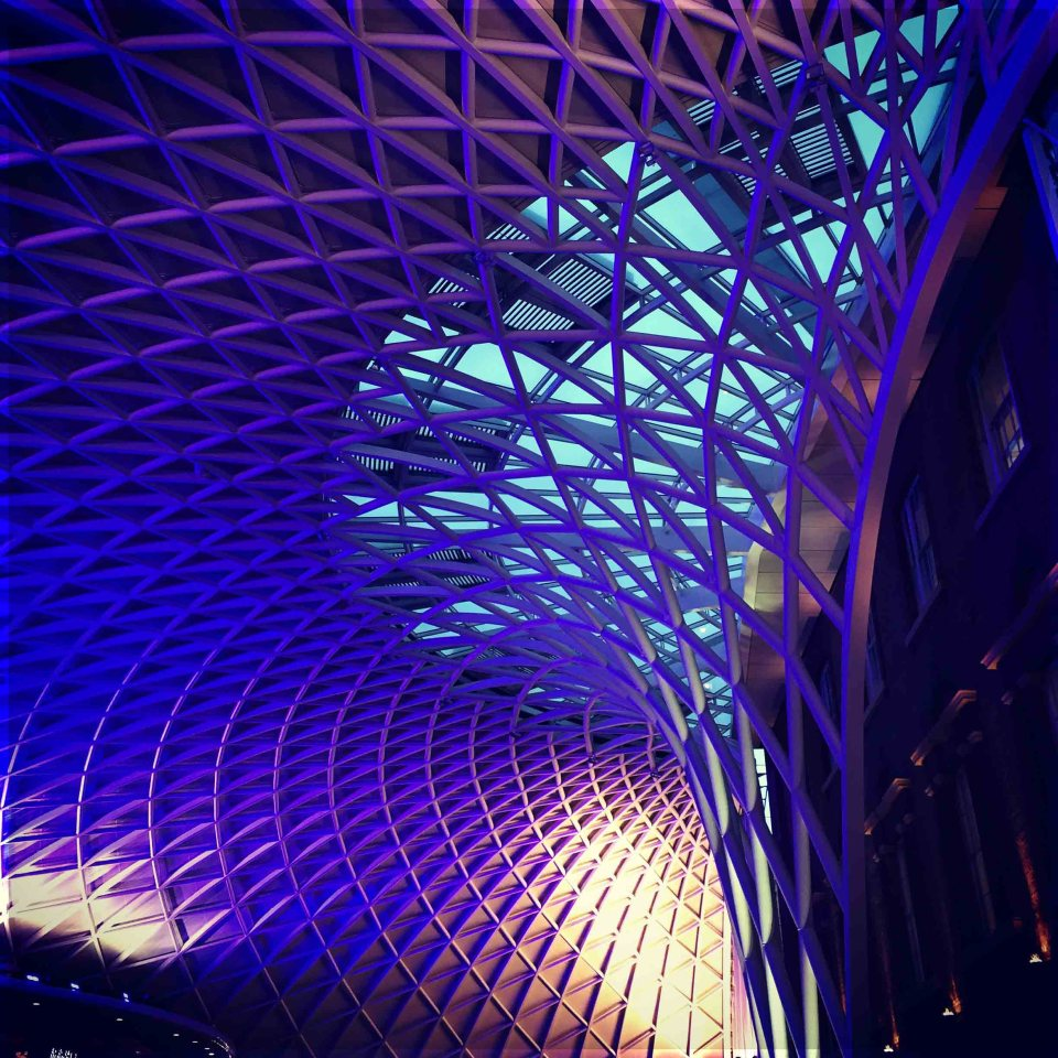 Intricate roof lit up in blue