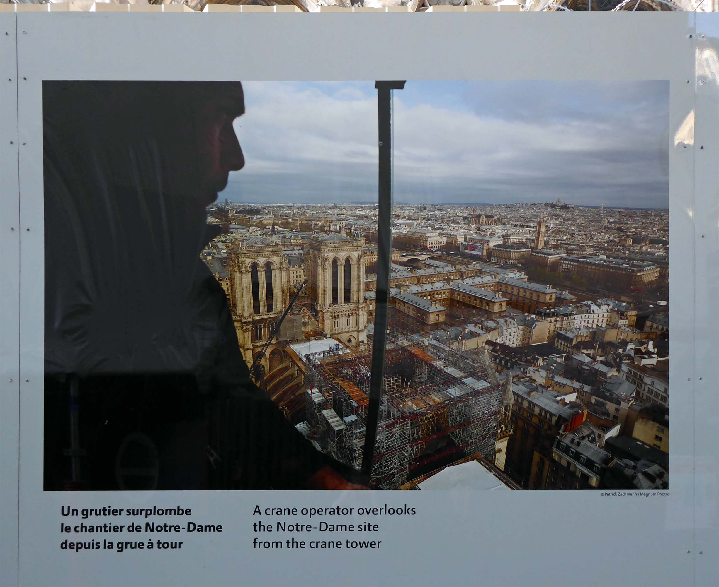 Photo of a man looking down on a city