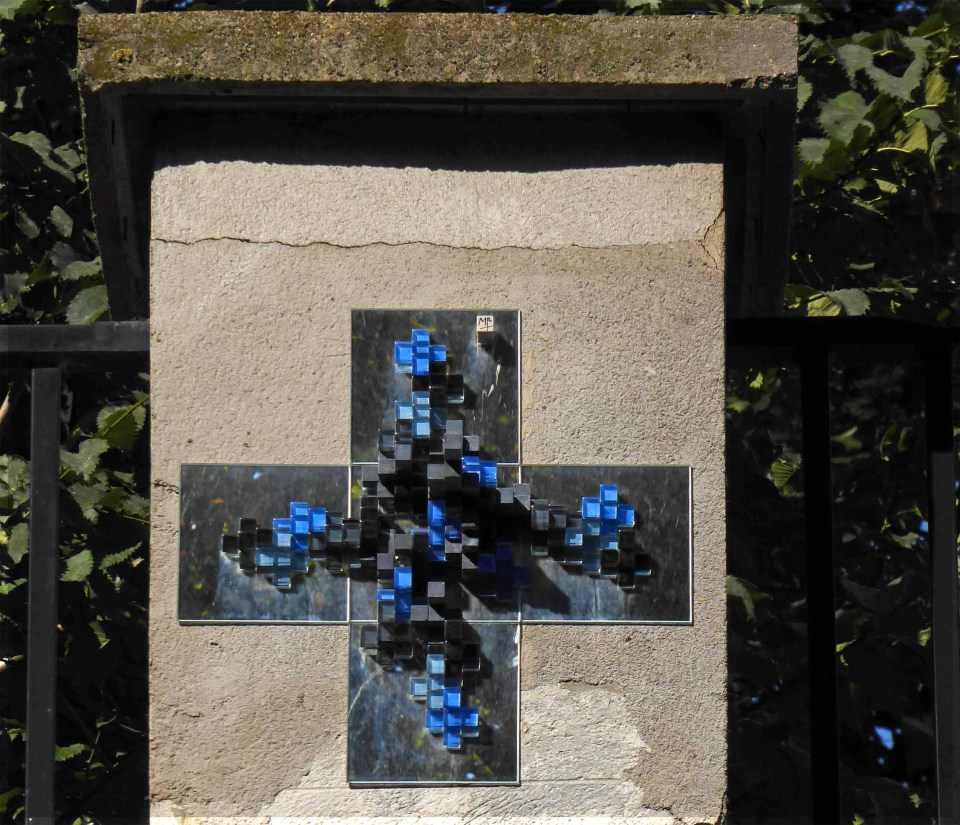 Cross shape decorated with blue glass mosaic tiles