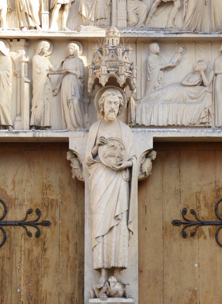 Statue of a saint between wooden doors