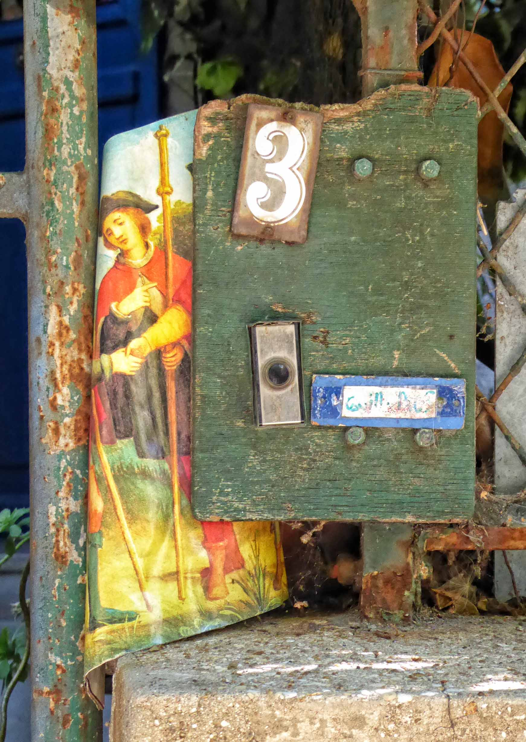 Metal gate with number 3 and small picture attached