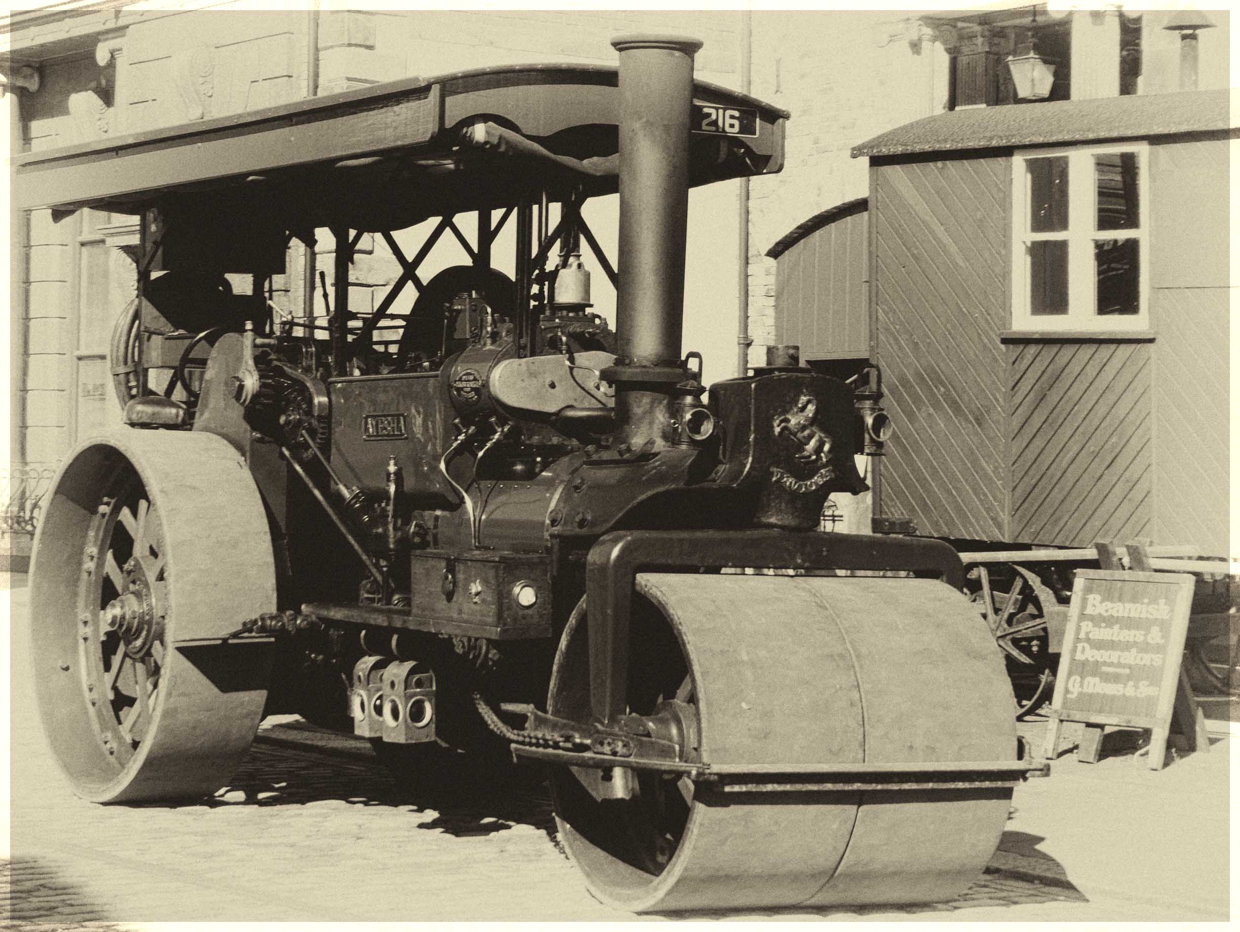 Sepia photo of an old steam roller