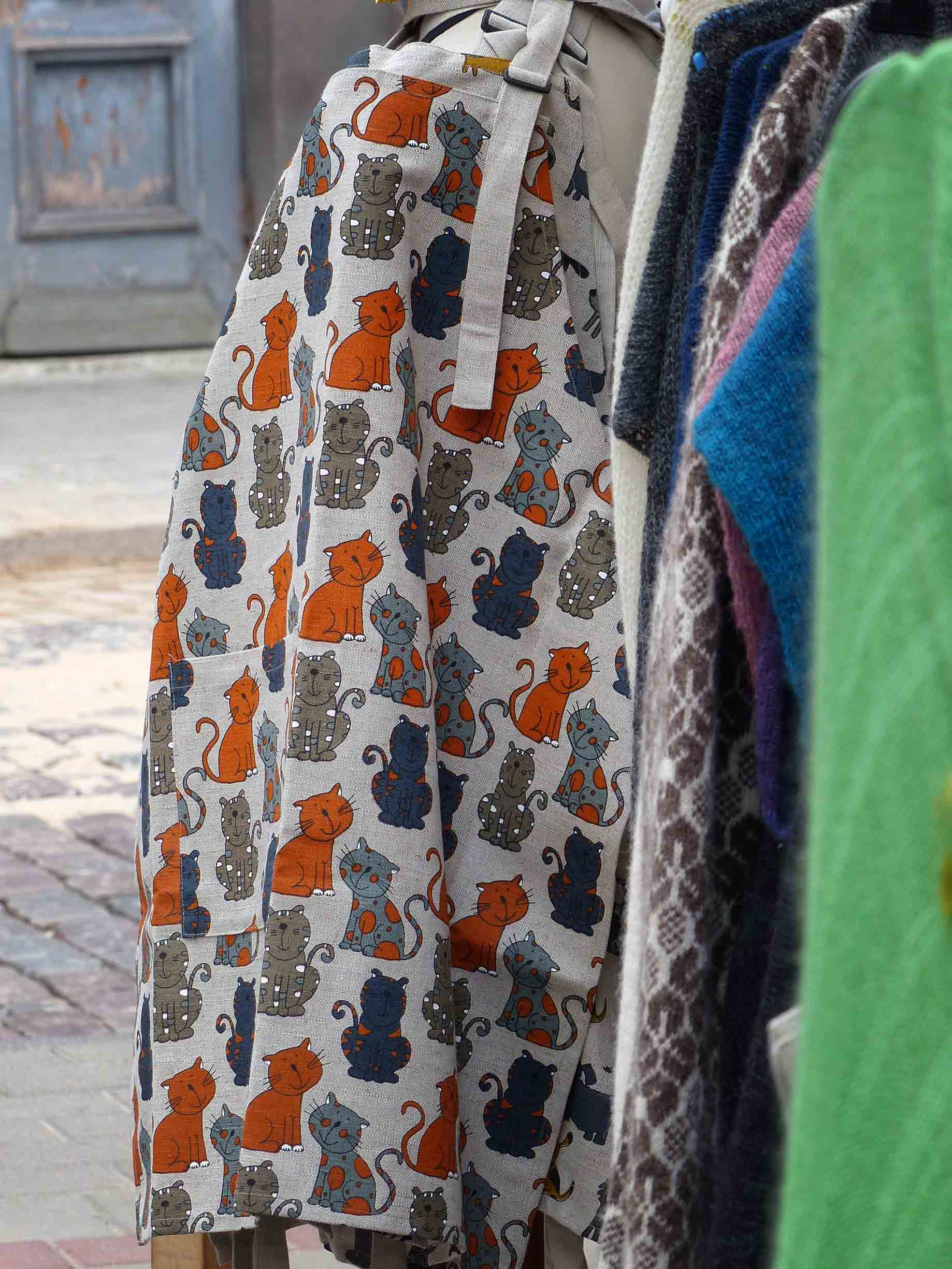 Fabric decorated with different colour cats