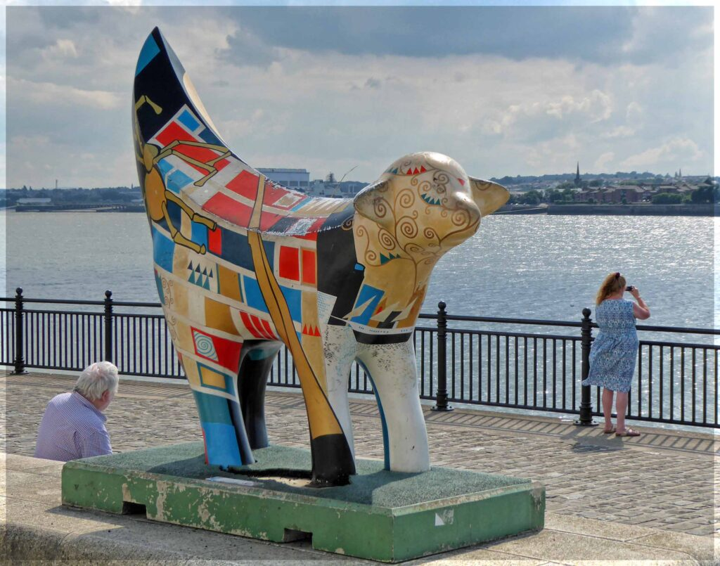 Odd large sculpture of a lamb, painted in bright colours