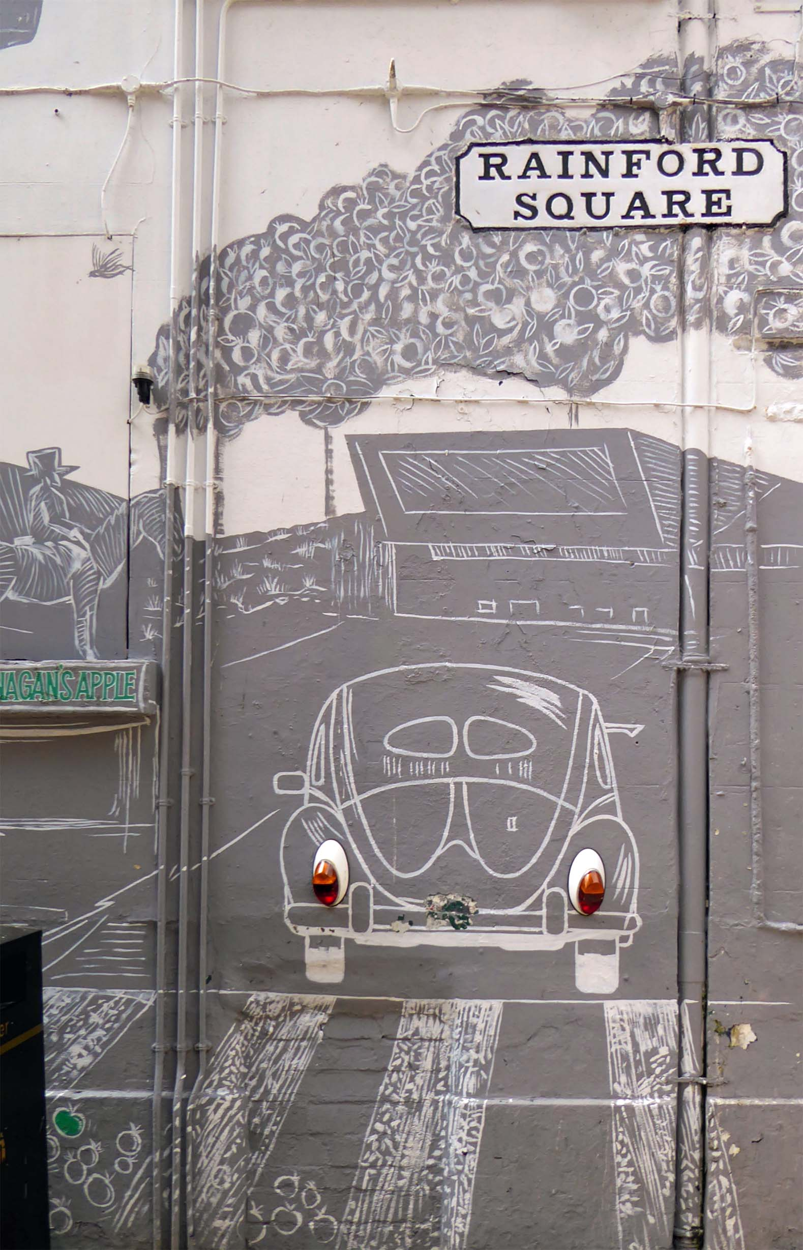 Grey wall painting of a car