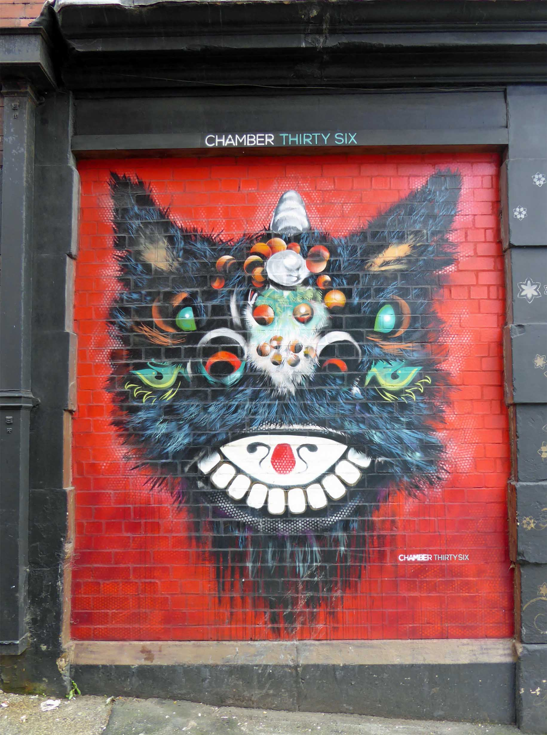 Bright mural of a hairy animal face