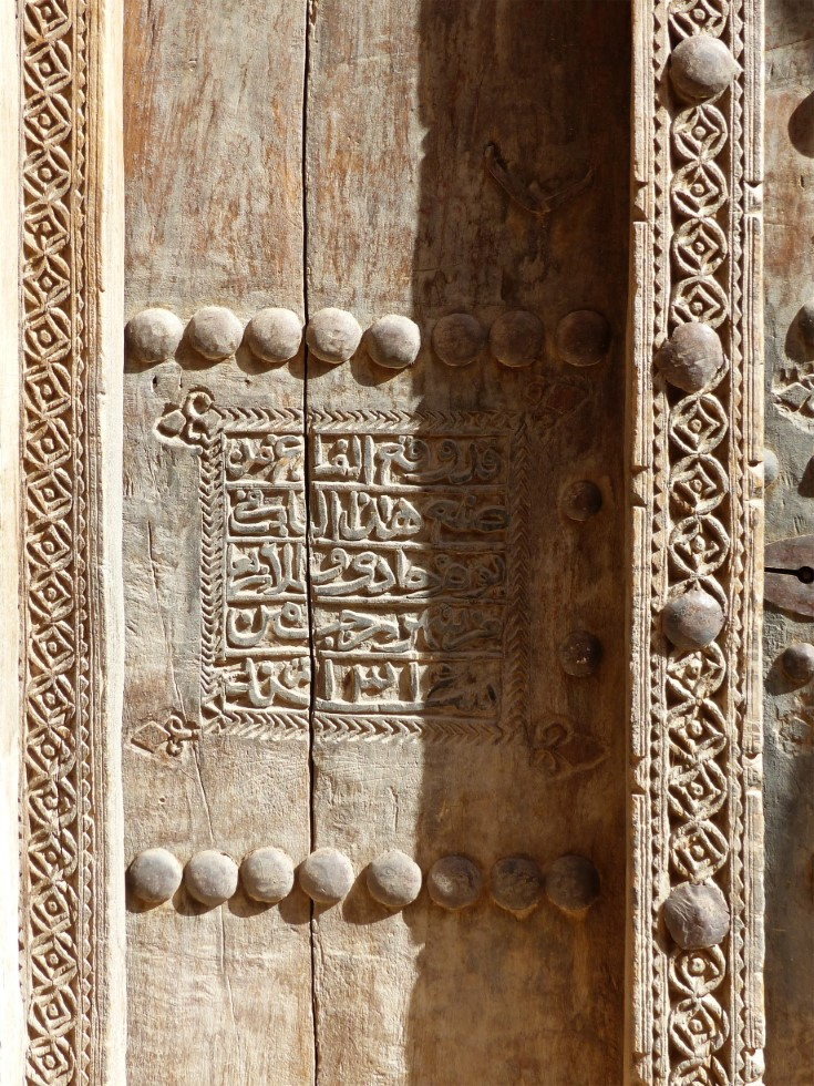 Close-up of carved wooden door