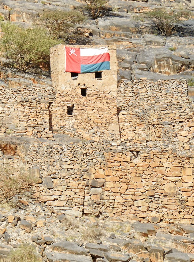 Stone ruins with flag hanging