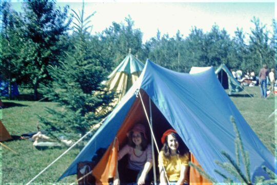 Two teenage girls in a tent