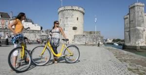 "They Call me Yellow Vélo... Some ladies pose with the free ""Yélo"" bikes."