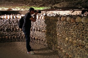 Say 'Cheese'! A tourist photographs a small section of the catacombs' bones