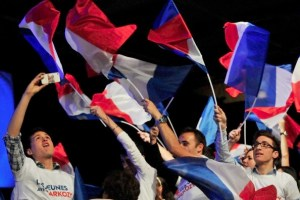 That'll cost you: supporters waving shiny new flags at a Sarkozy rally in March, 2012