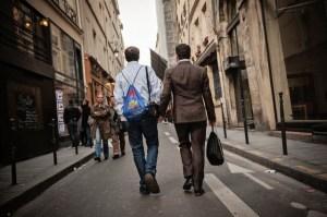 Main-en-main: a couple of Marais residents strolling its historical streets