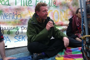Mel MacGiobúin reading at the DubDebout event in Dublin on May 1st