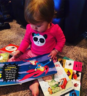 The superhero book is her favorite right now.