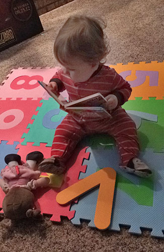 baby playing independently