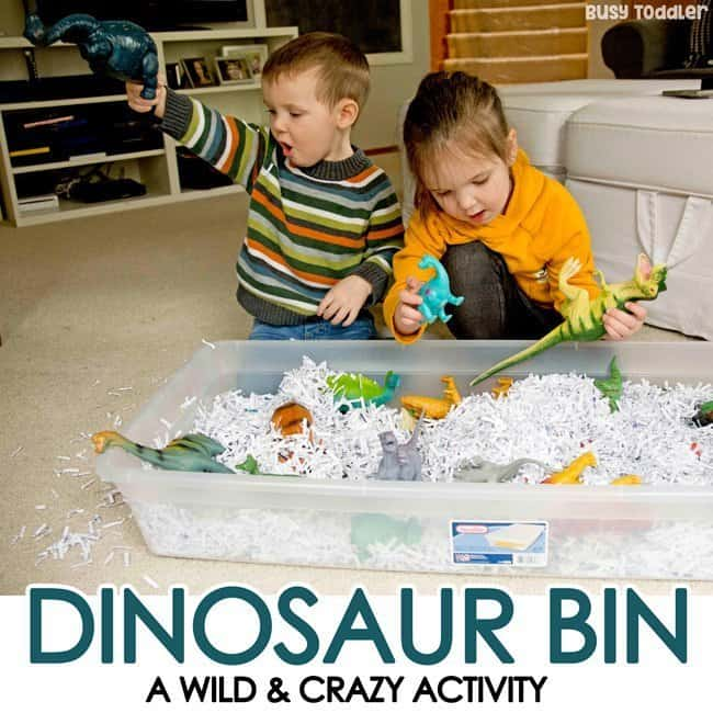 Dinosaur Sensory Bin with Shredded Paper