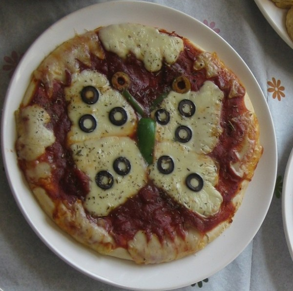 Cheese And Tomato Pizza That Looks Like a Butterfly