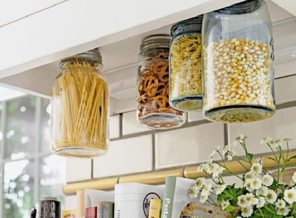 Mason Jars Screwed Under Kitchen Cabinet