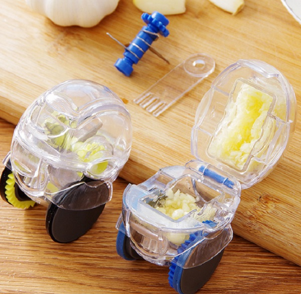 Push-Along Garlic Press