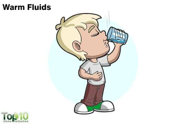 give warm fluids to children to treat sore throat