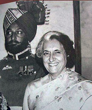 Indira Gandhi accompanied by Beant Singh, one of the body guards who murdered Mr. Gandhi.